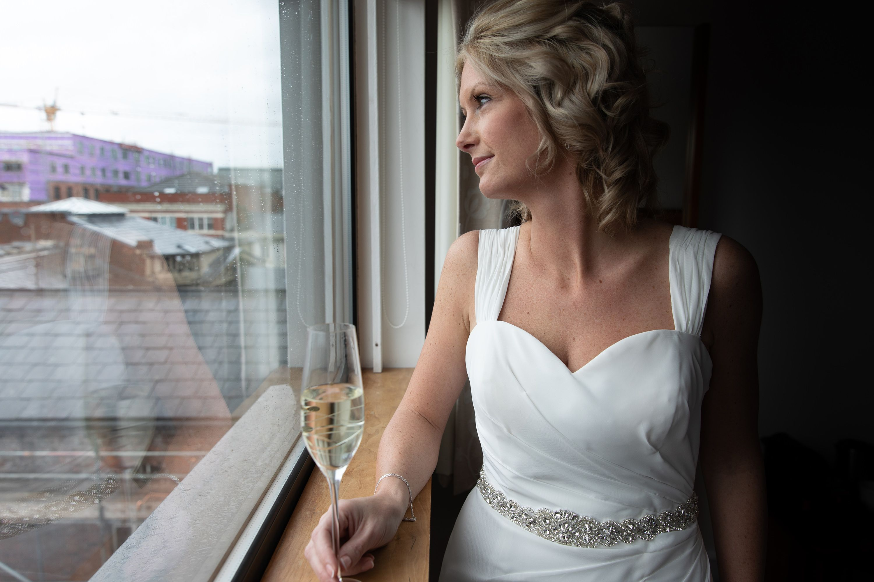 the bride looking out of the window gathering her thoughts