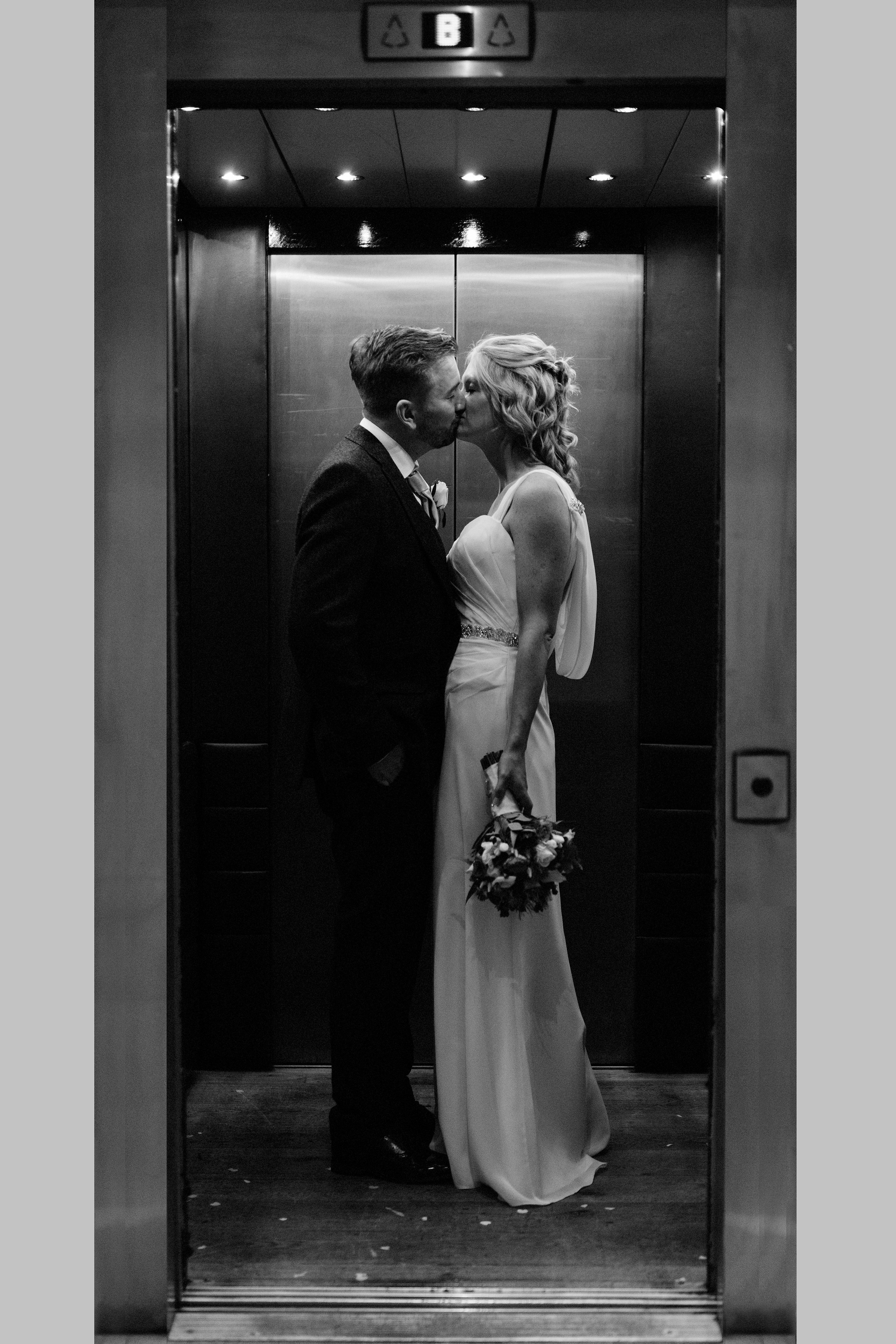 Adam and Laura sneak a quick kiss in the elevator of the  Hope Street Hotel in Liverpool