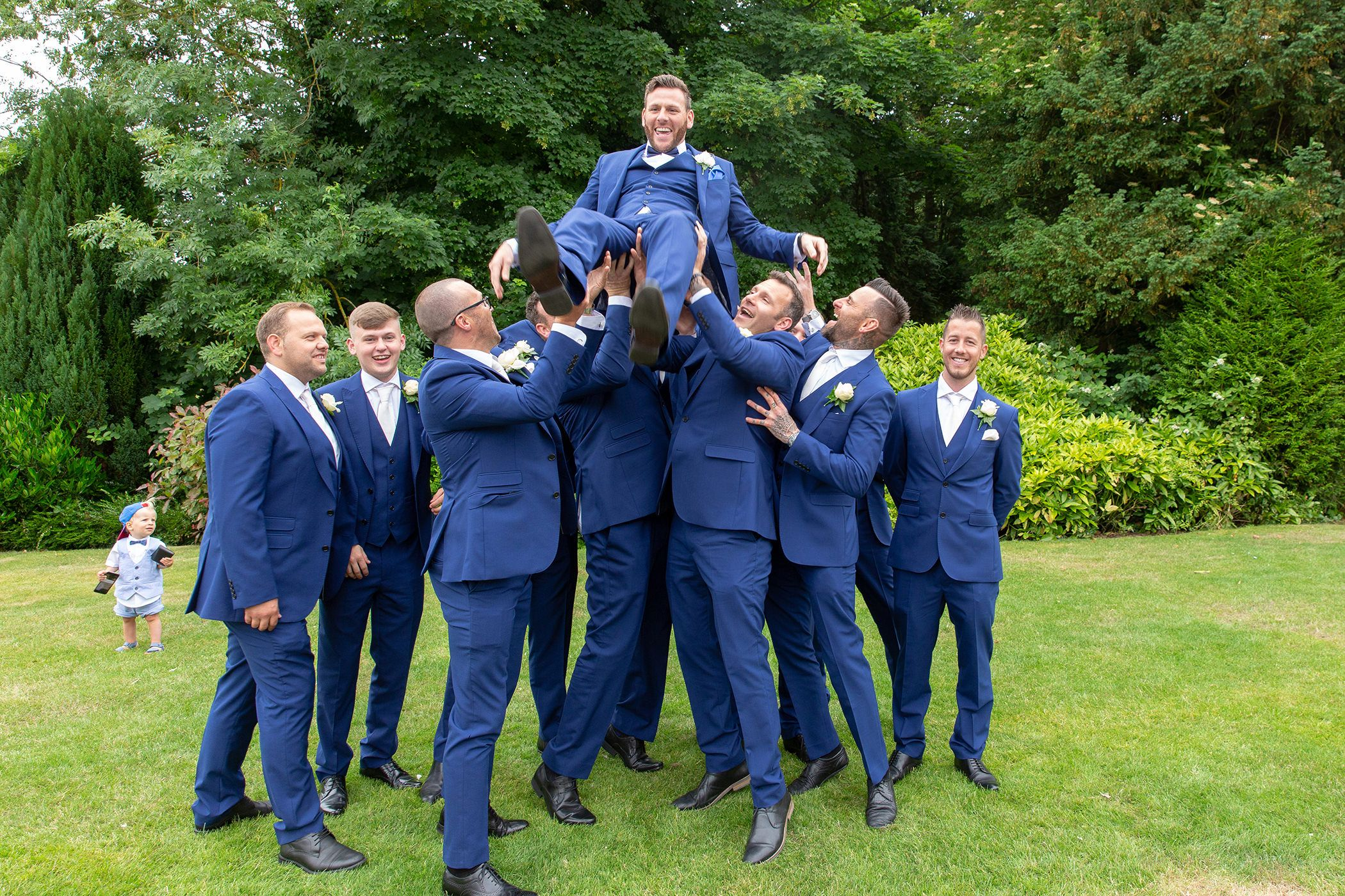the groom gets thrown in the air