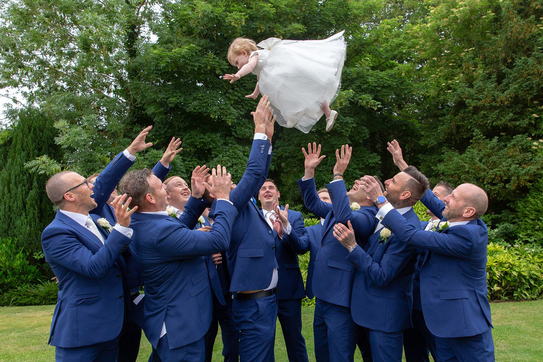 the flower girl gets thrown in the air