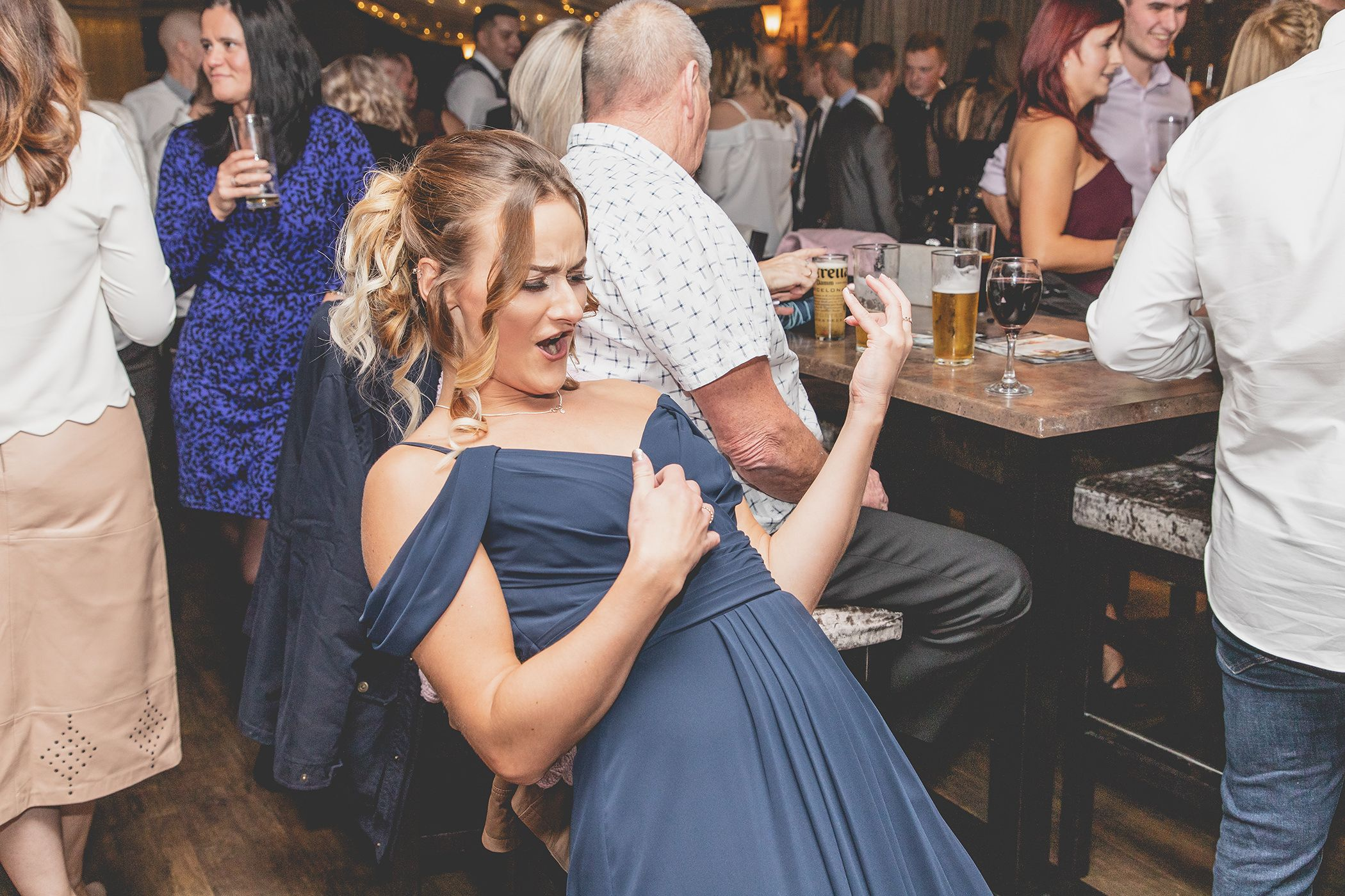 the bridesmaid doing an air guitar