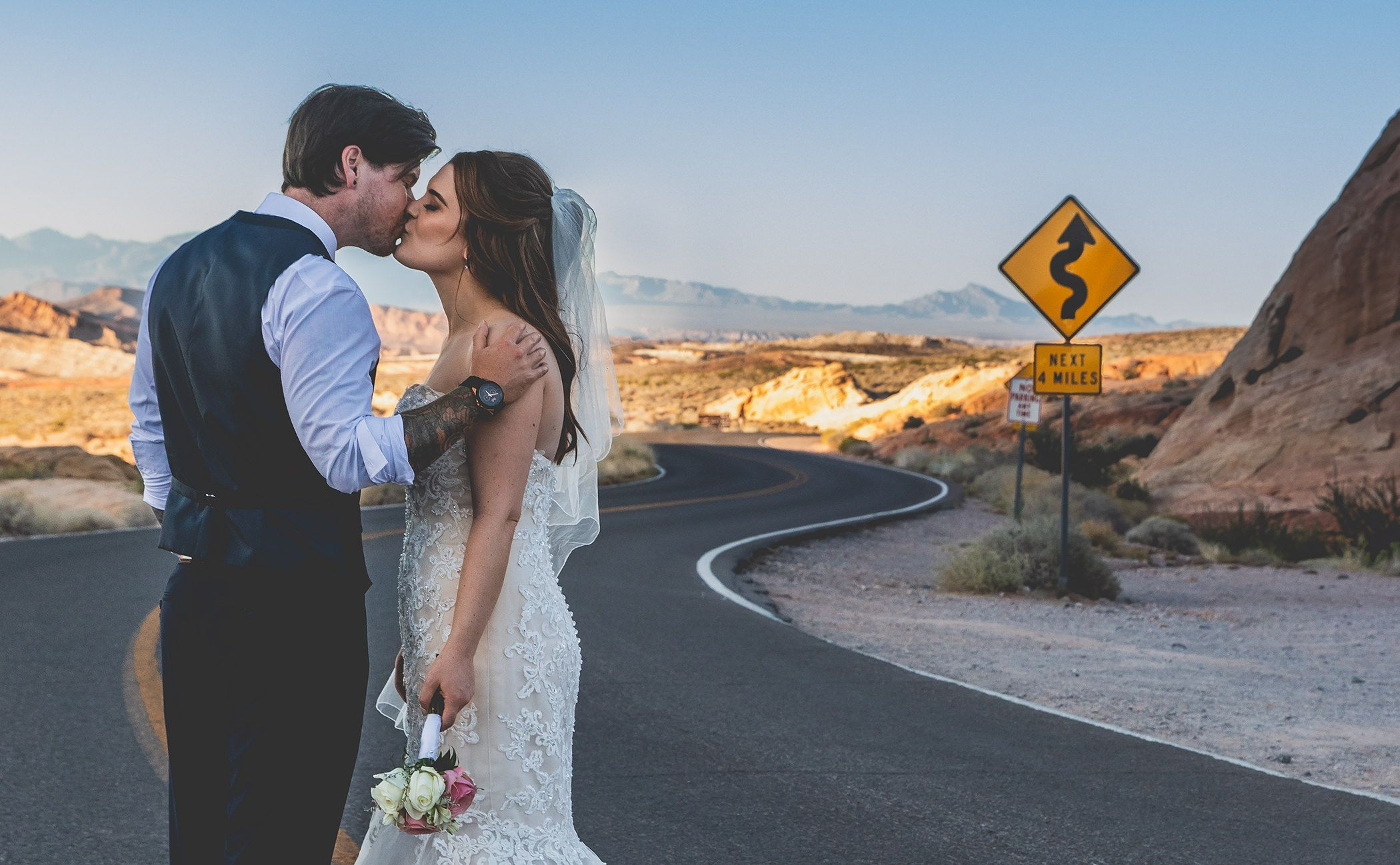 Valley of fire winding roads wedding couple kiss