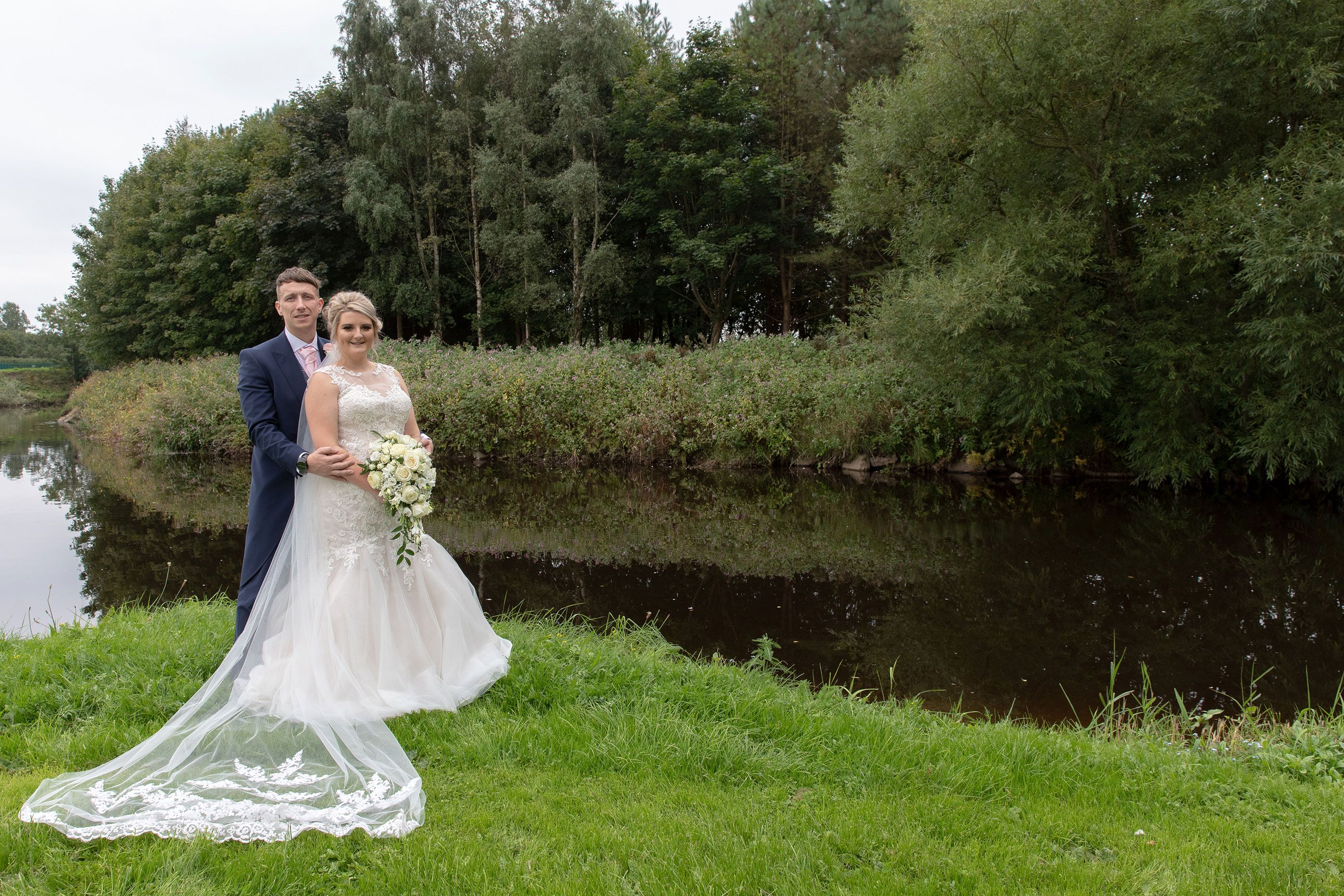 the bride and groom by the canal