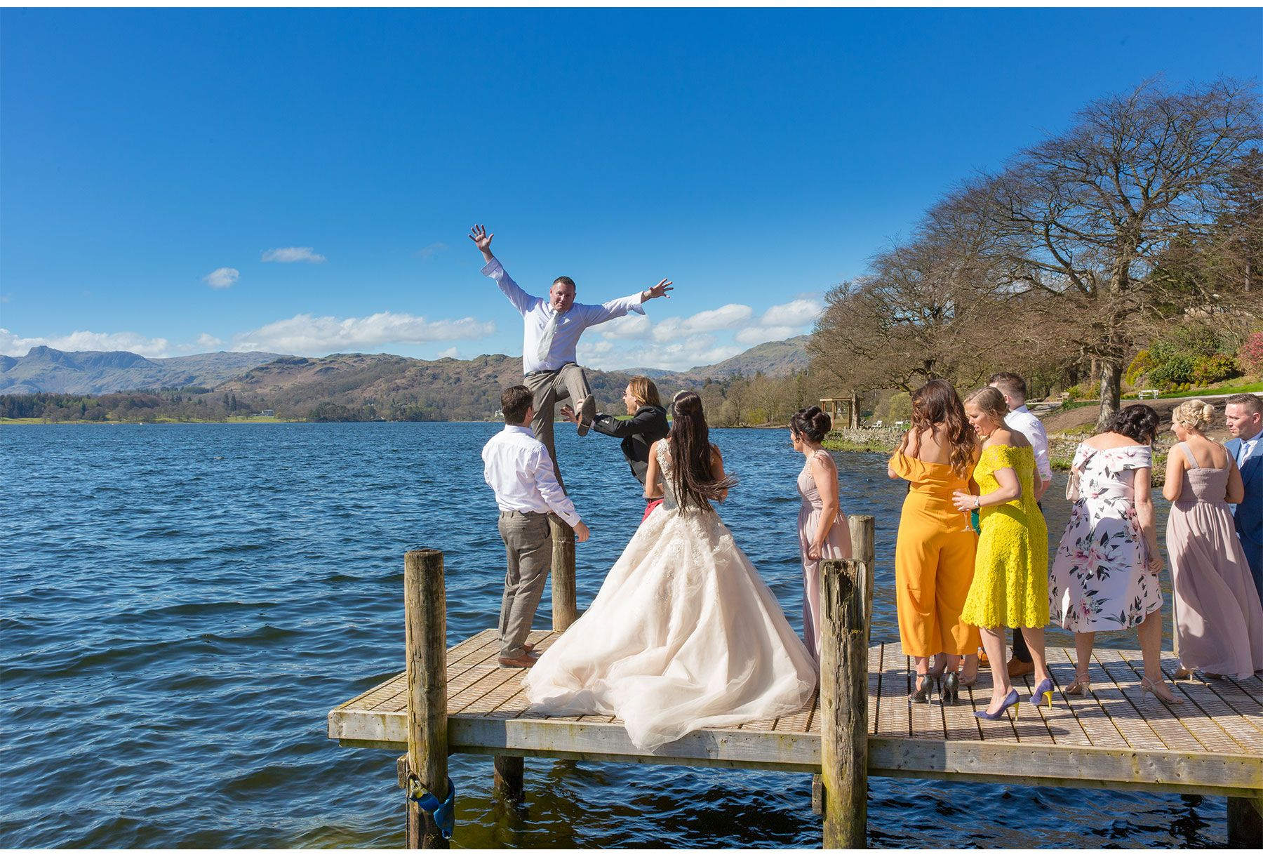 the groom messing around on the jetty