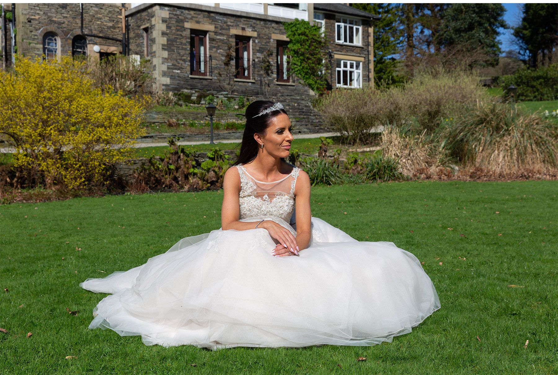 bride sat on the lawn