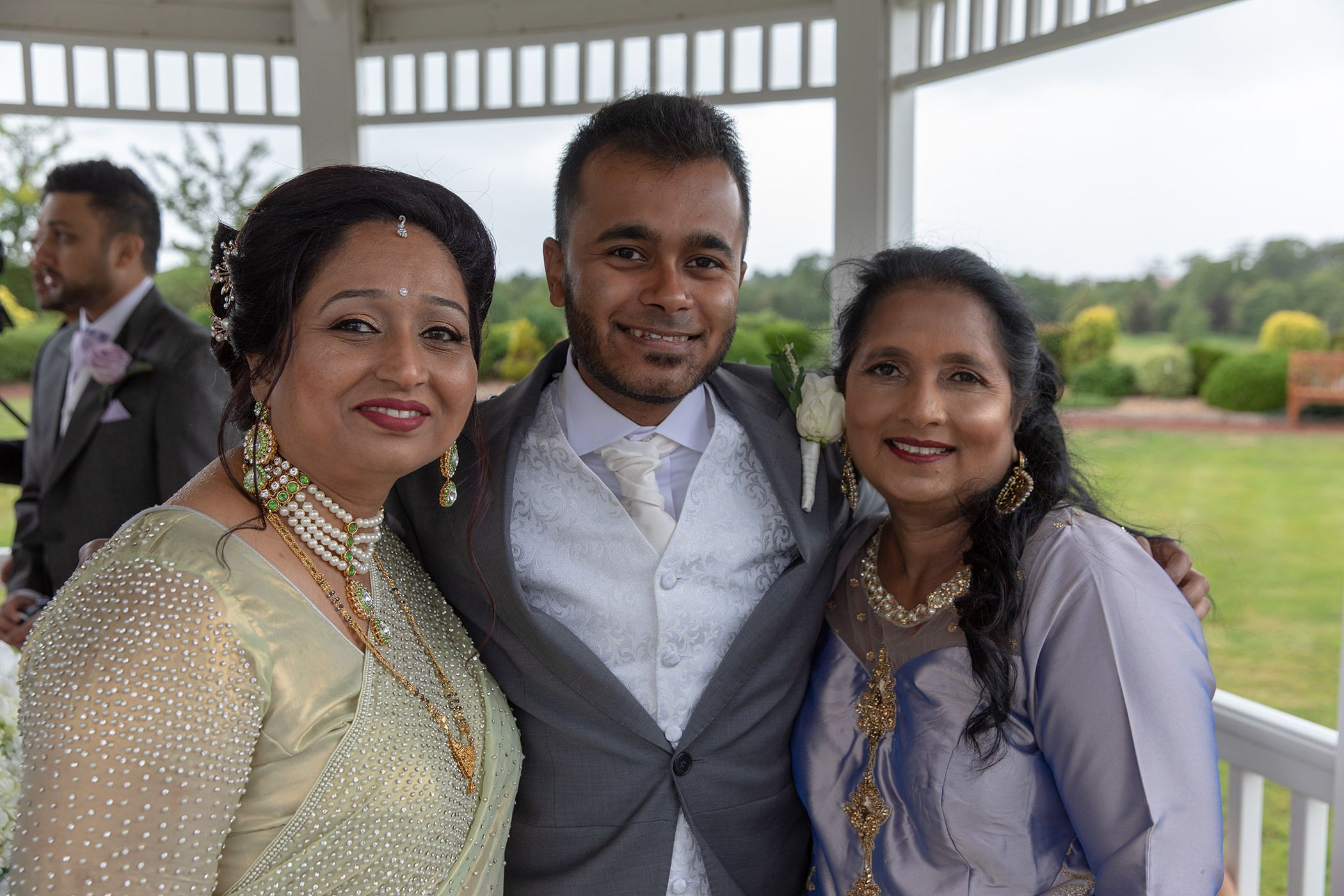 the groom with both mothers