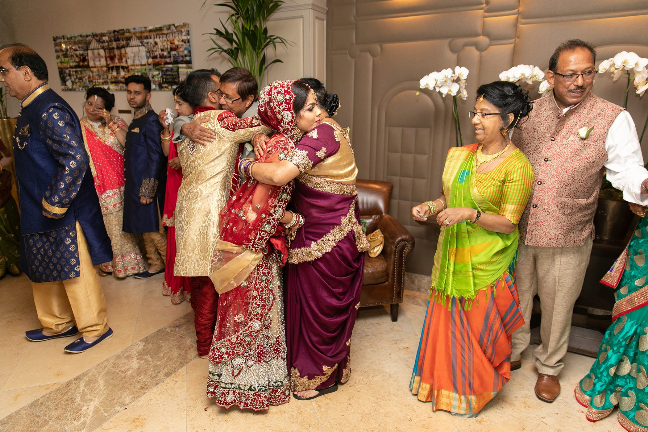 Indian wedding bride saying goodbye to parents