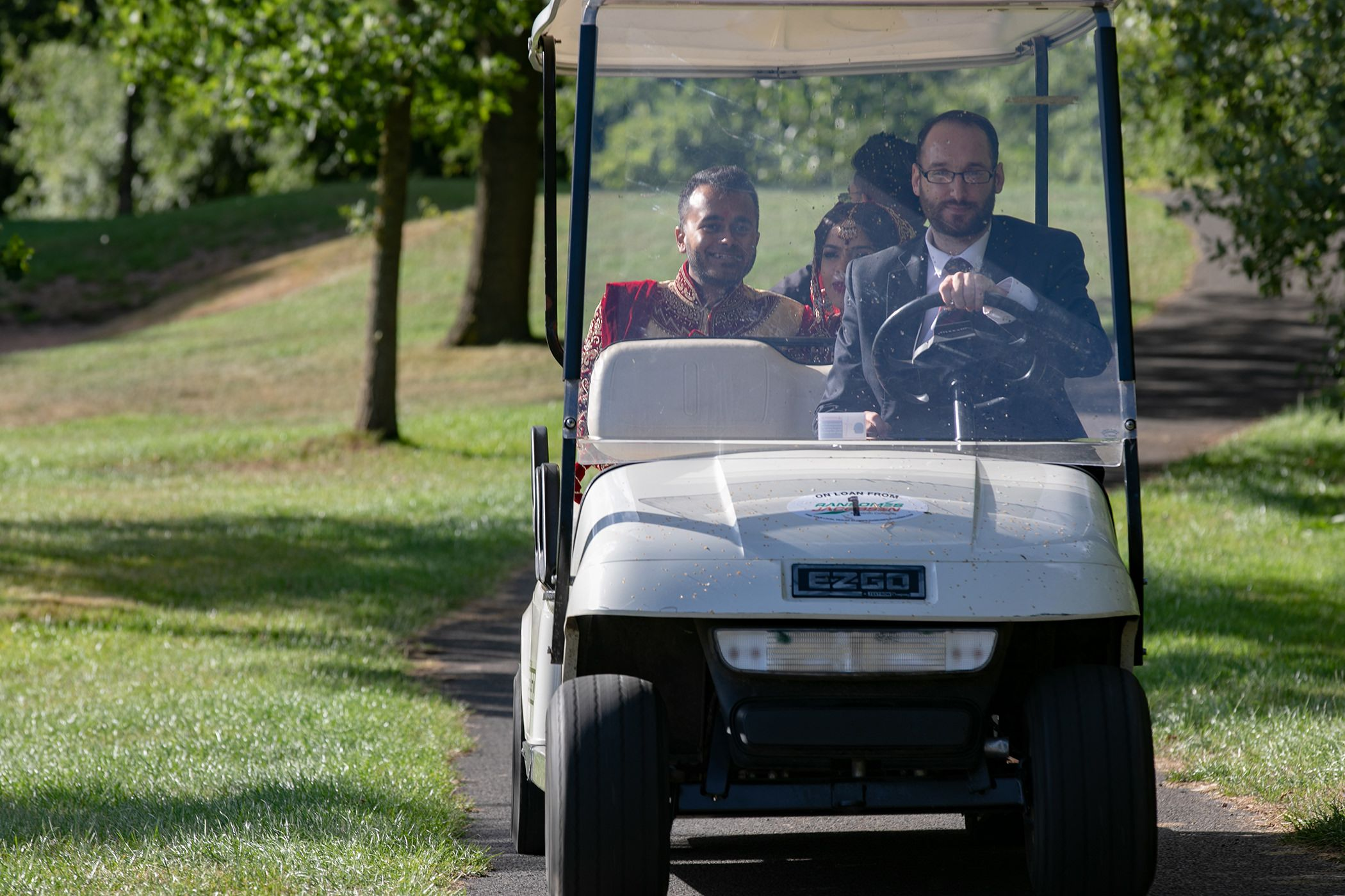 bride and groom golf buggy