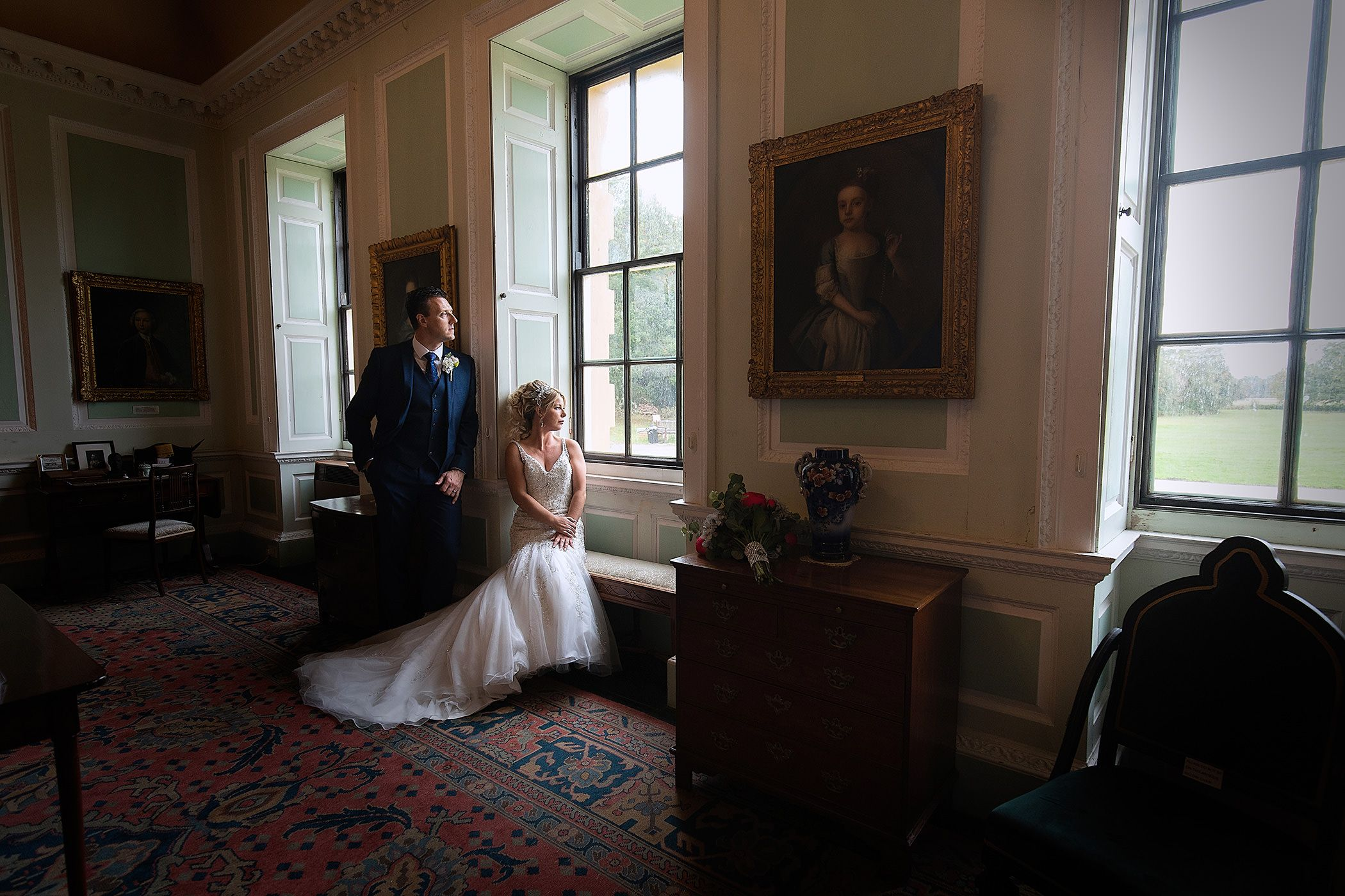 The bride and groom in the front of the house at Lytham Hall