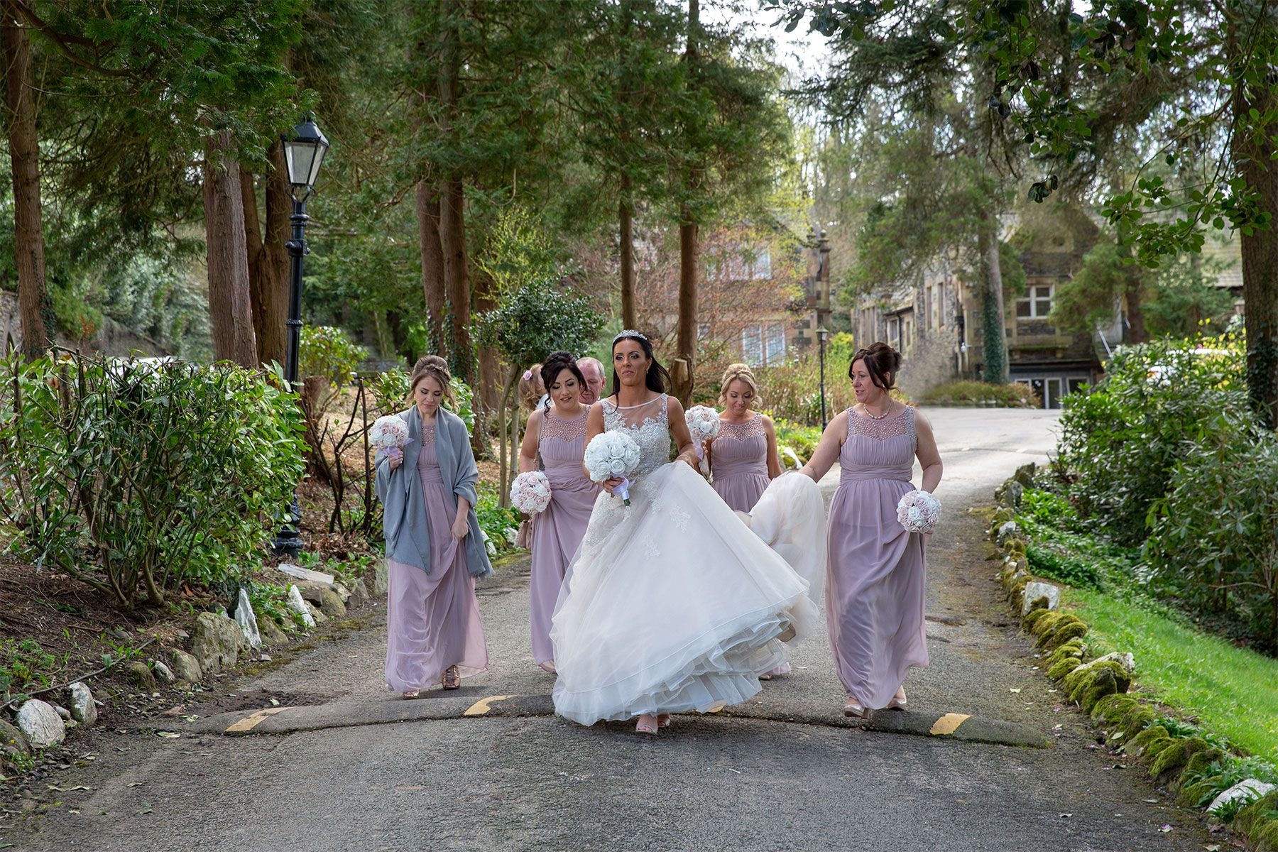 Bride and the bridesmaids walking down the driveway