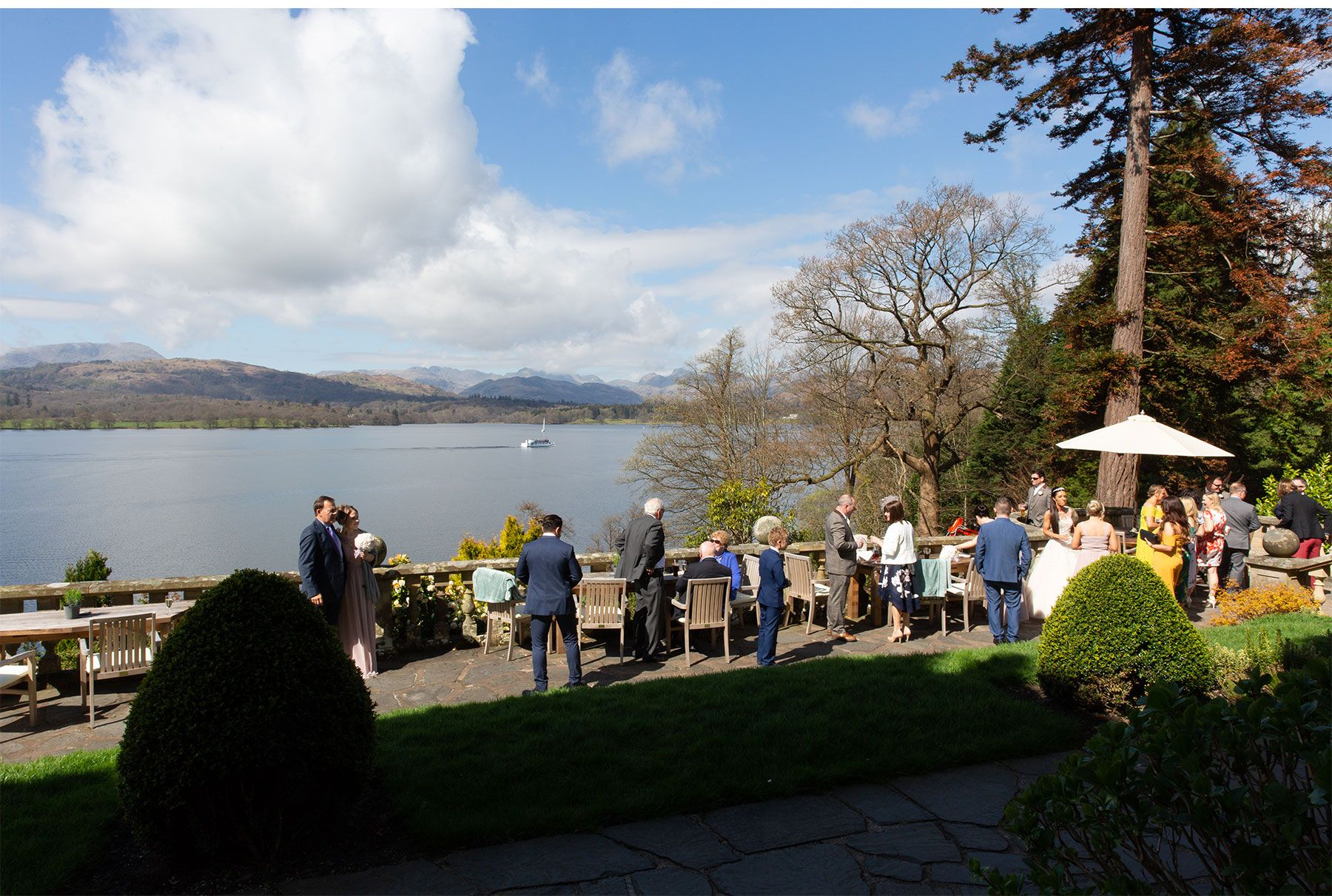 Wedding party with views over lake windermere