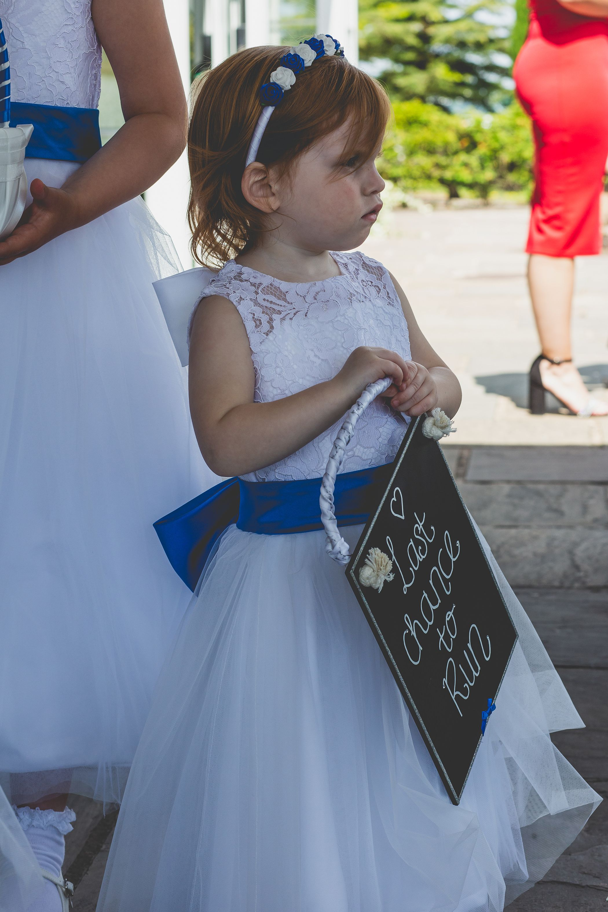 flower girl with sign
