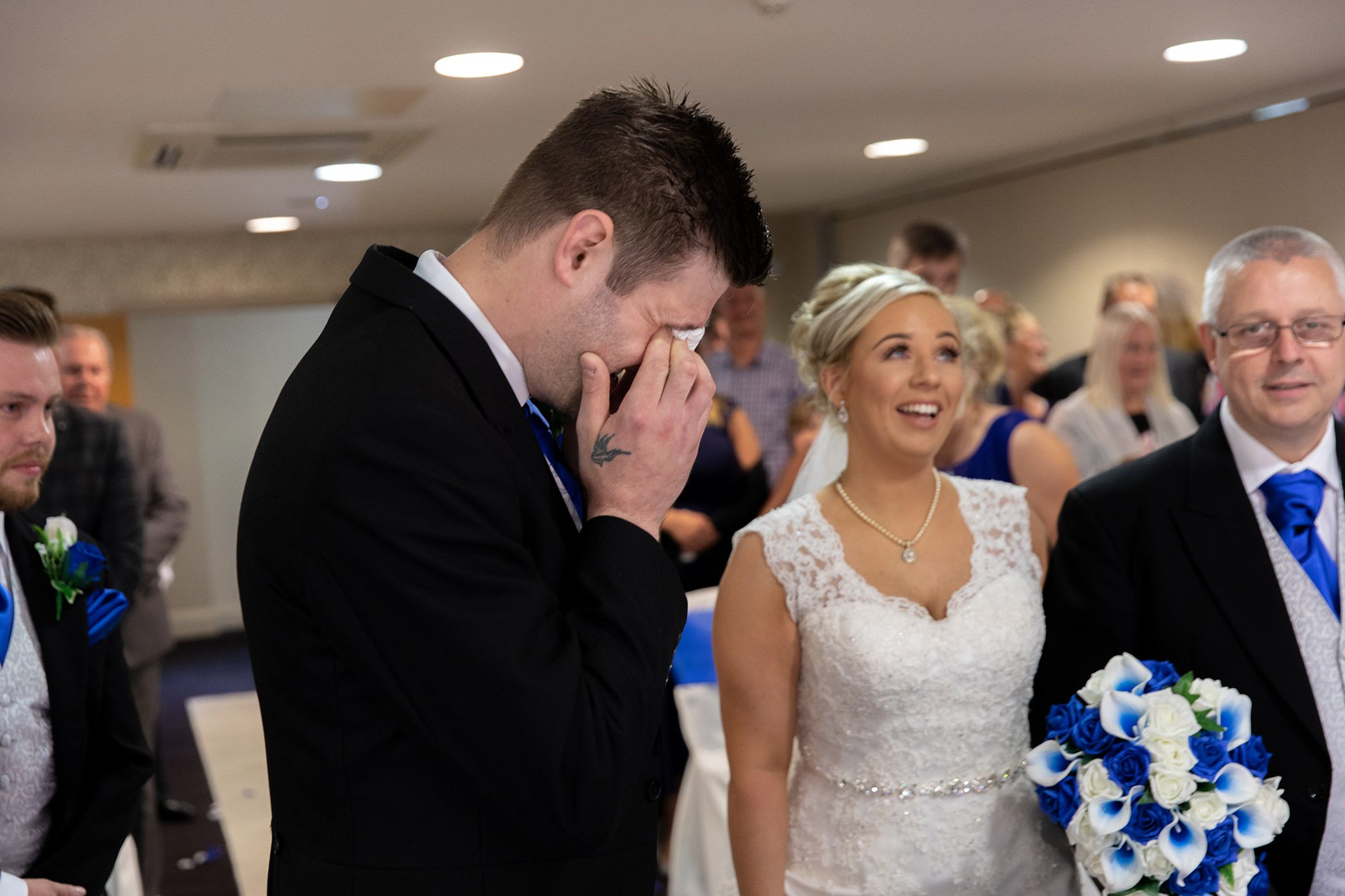 The groom cries as he sees his bride