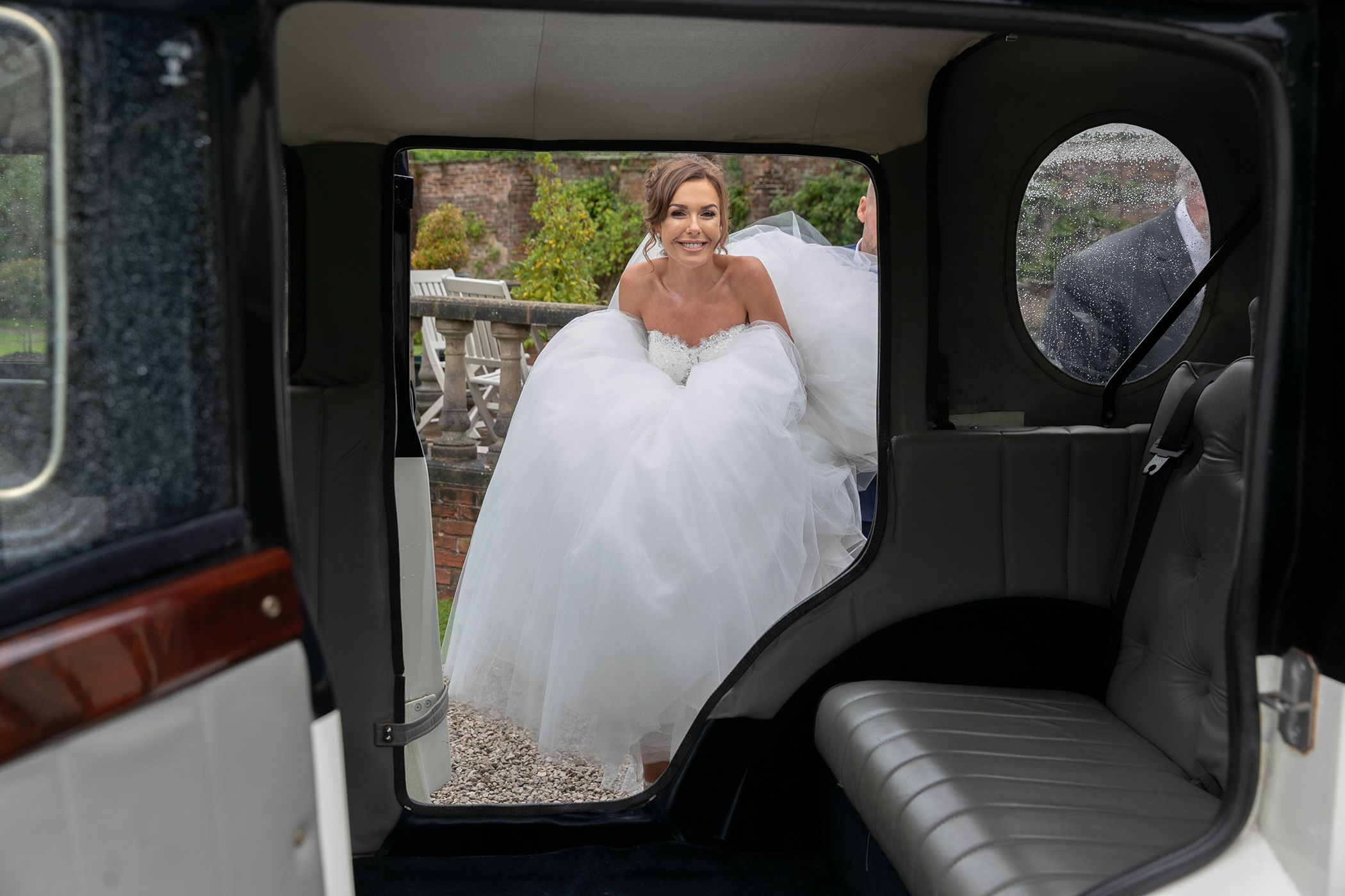 bride getting in the car