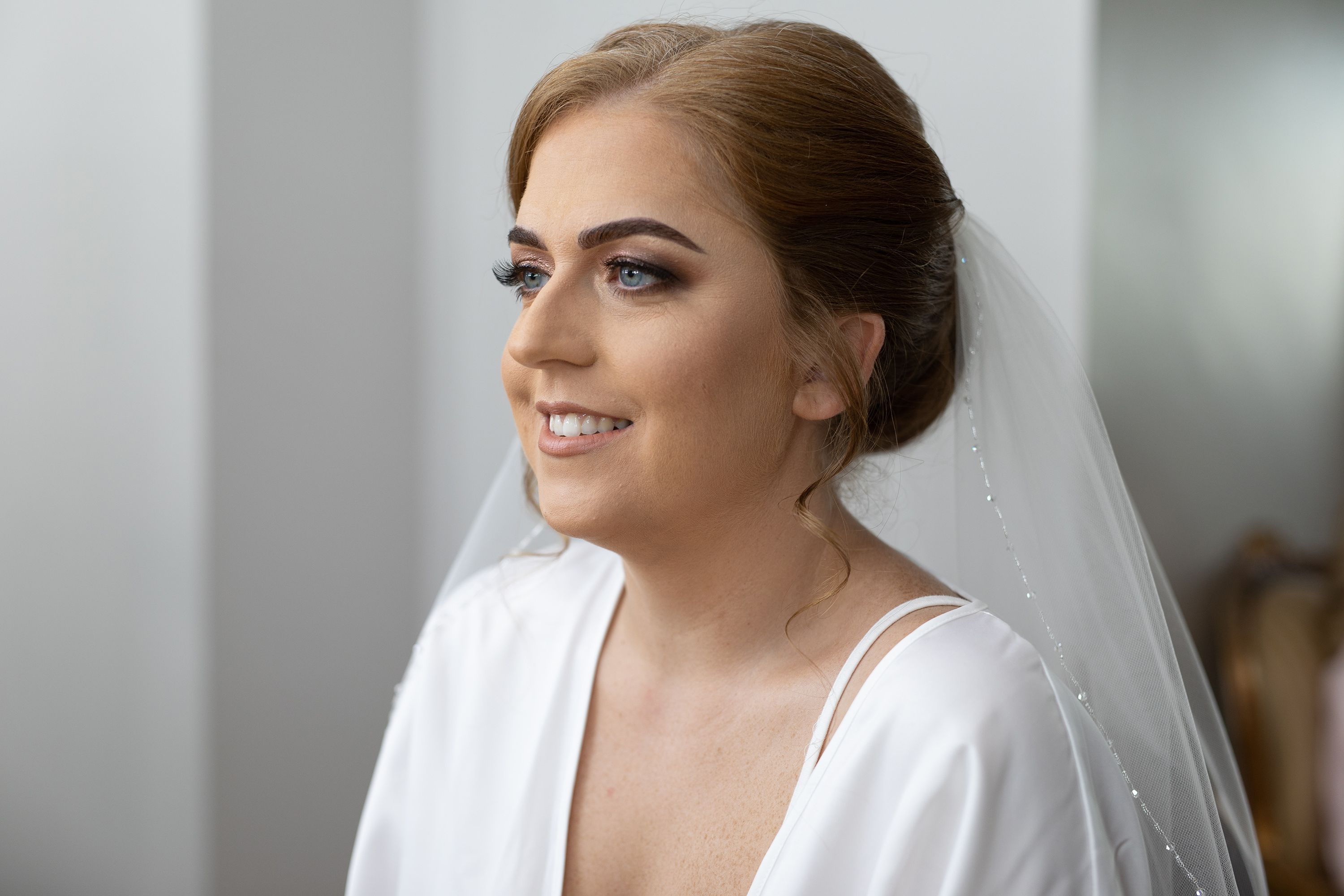 the bride has her makeup ready