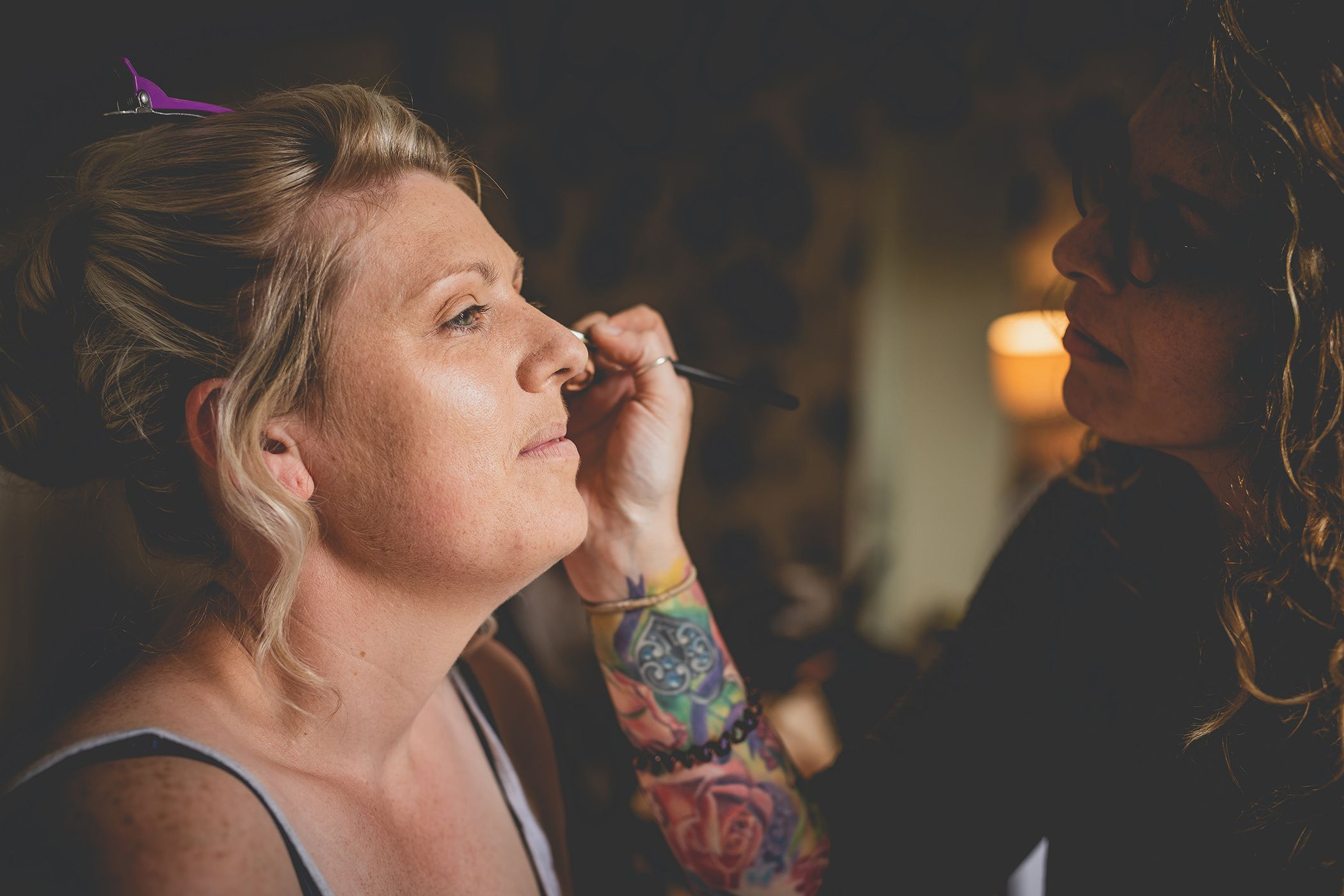 bride having her makeup put on