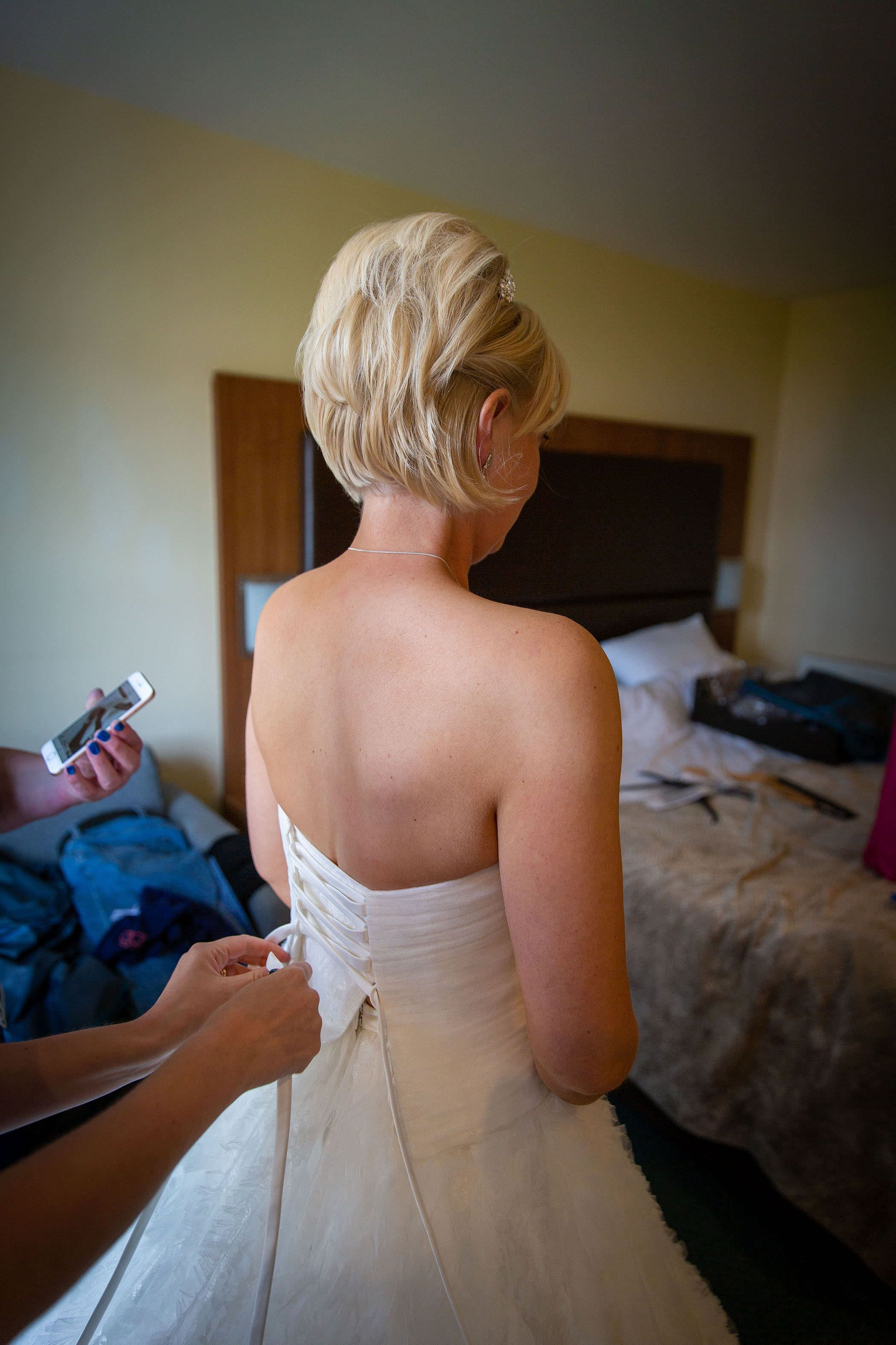 the tieing up of the wedding dress
