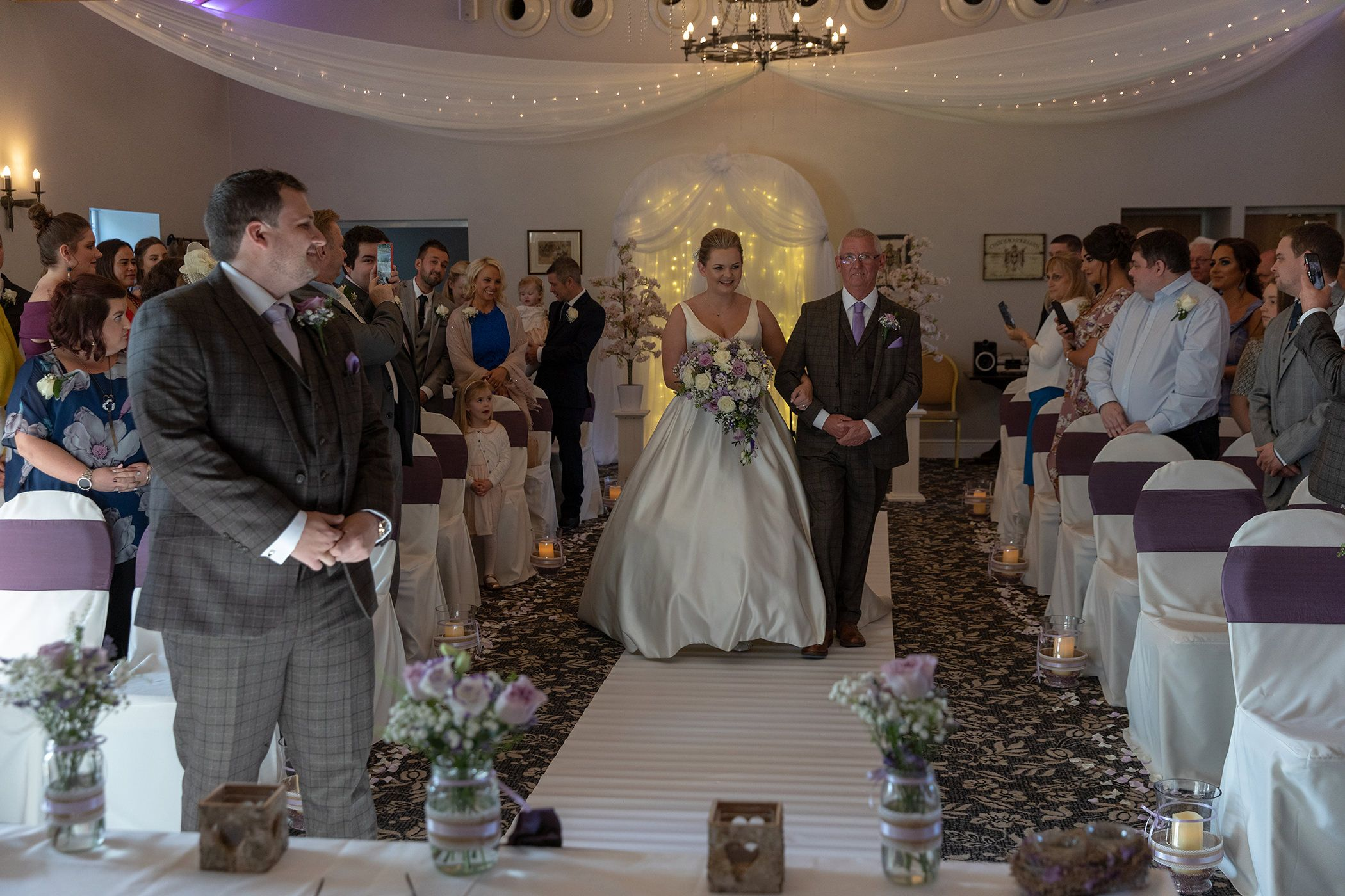 the bride walks down the aisle