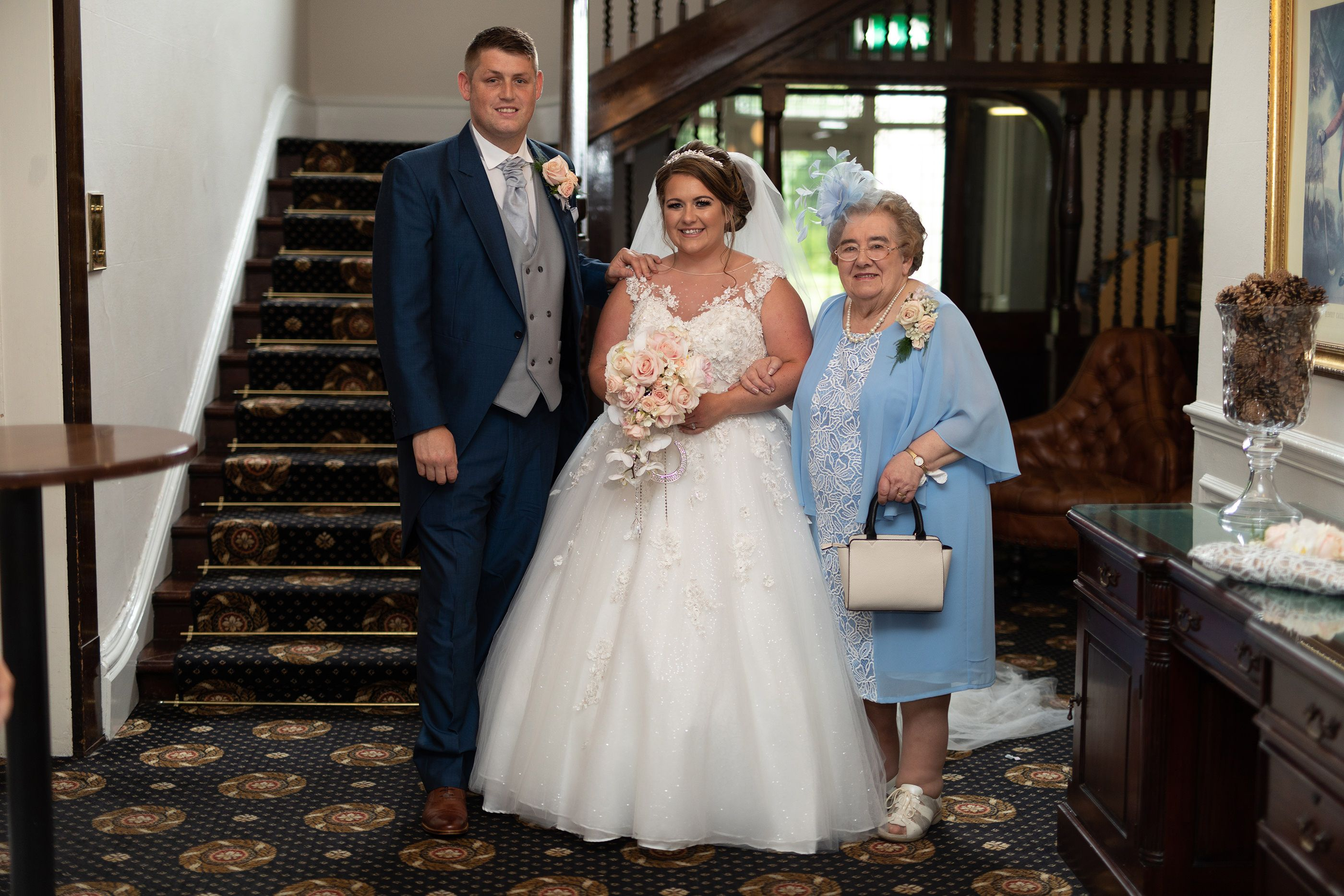 bride and groom with their grandmother
