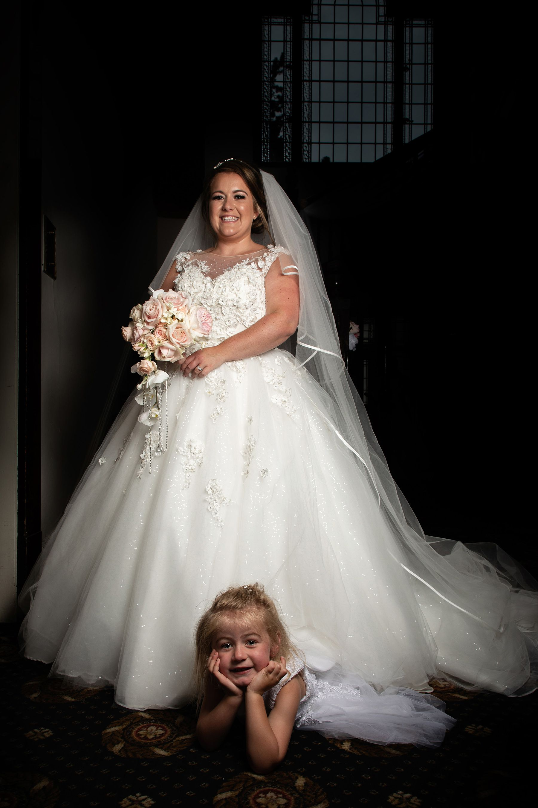 the bride and her daughter under the wedding dress