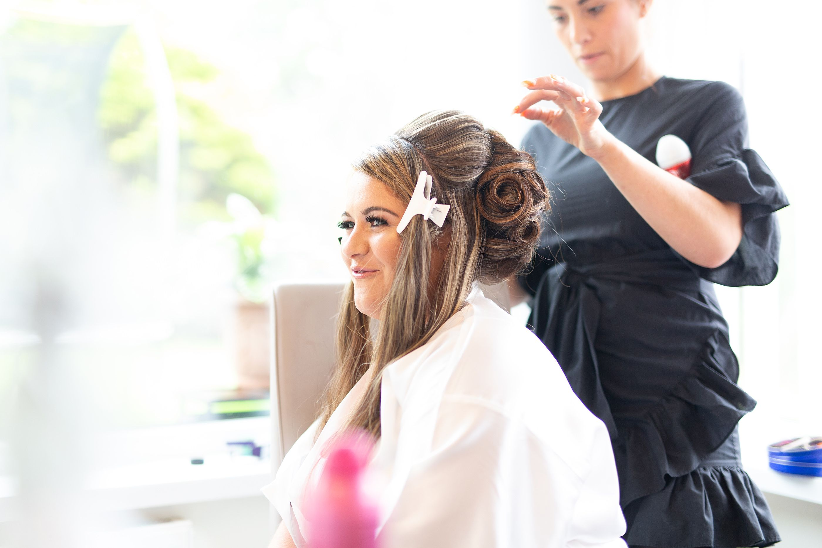 the bride getting her hair done