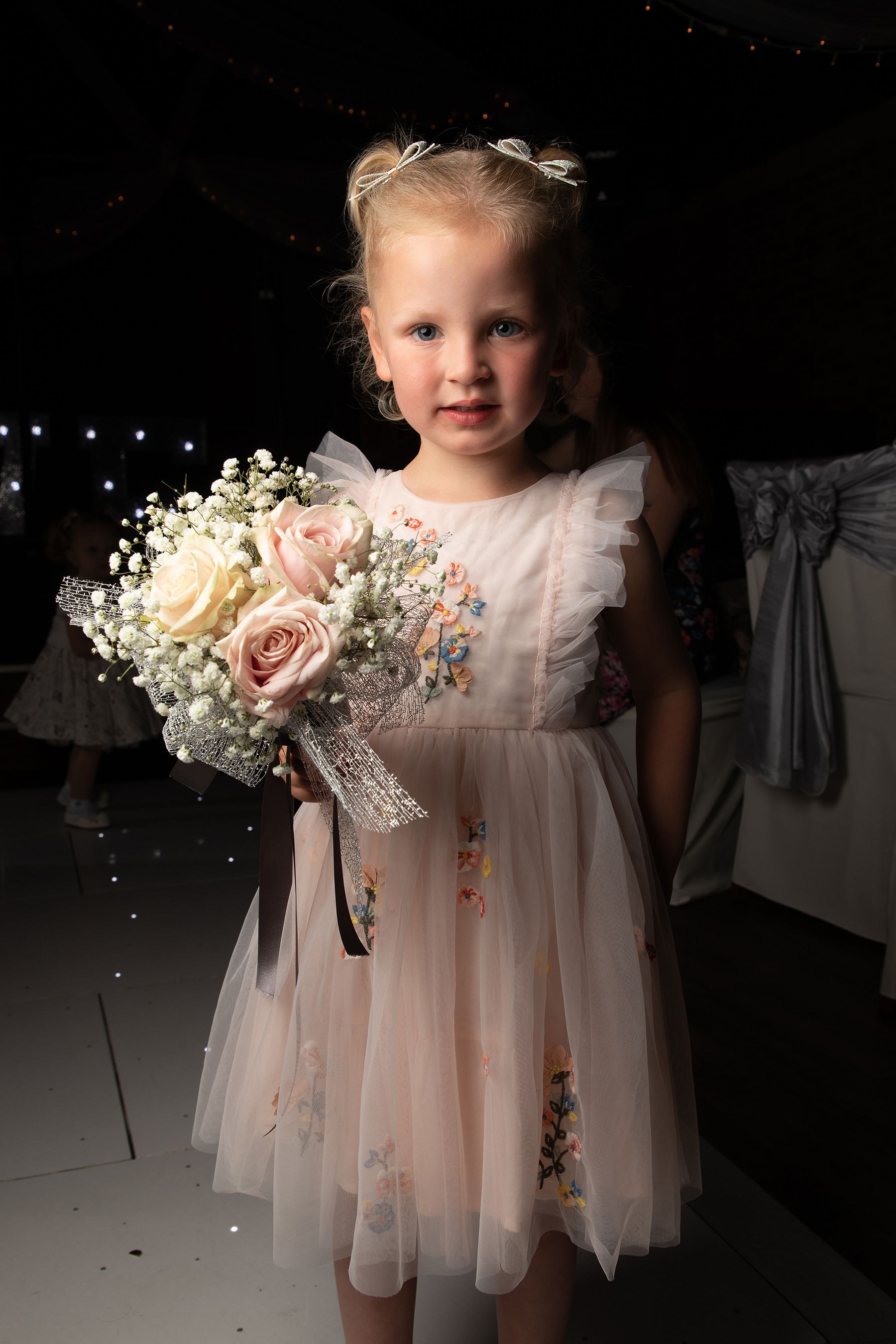 little girl holding the bouquet