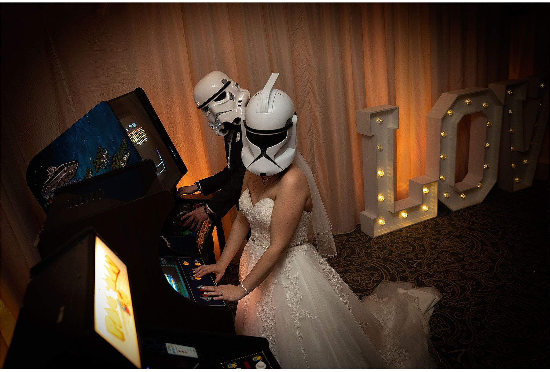 Bride and Groom having fun with arcade games